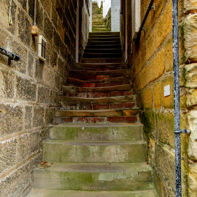 """""""Robin Hoods Bay, Yorkshire East Coast, Narrow Ginnel with Steps"""" stock image"""