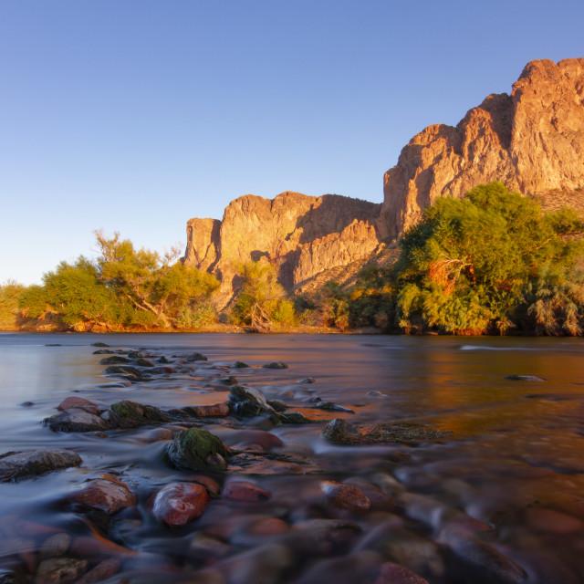 """Water flowing over rocks in the desert"" stock image"