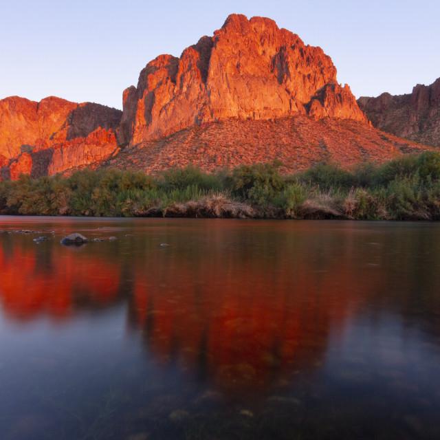 """""""Brilliant orange mountain reflection"""" stock image"""