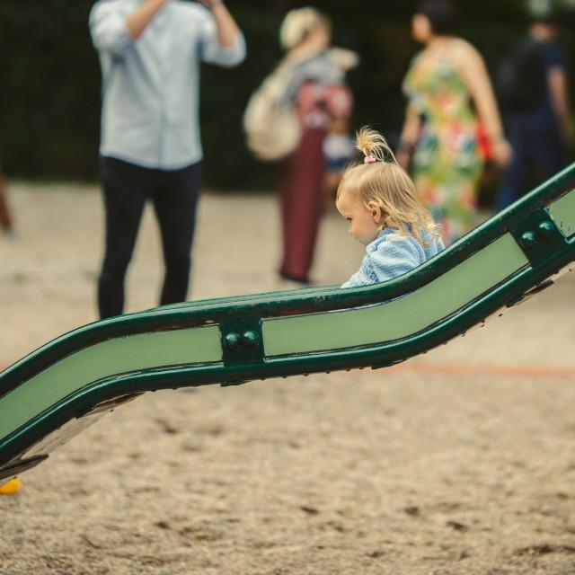 """blonde haired girl on the slide"" stock image"