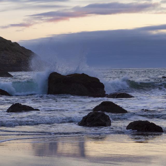 """""""Waves crash along the coast"""" stock image"""