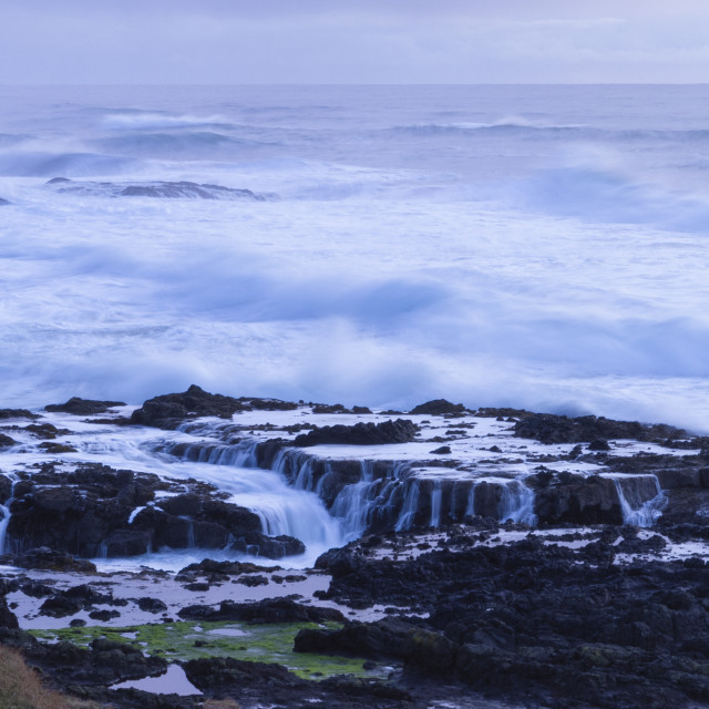 """Rough seas at dusk"" stock image"
