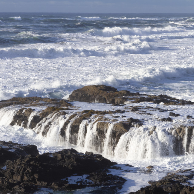 """Rough ocean washing over rocks"" stock image"