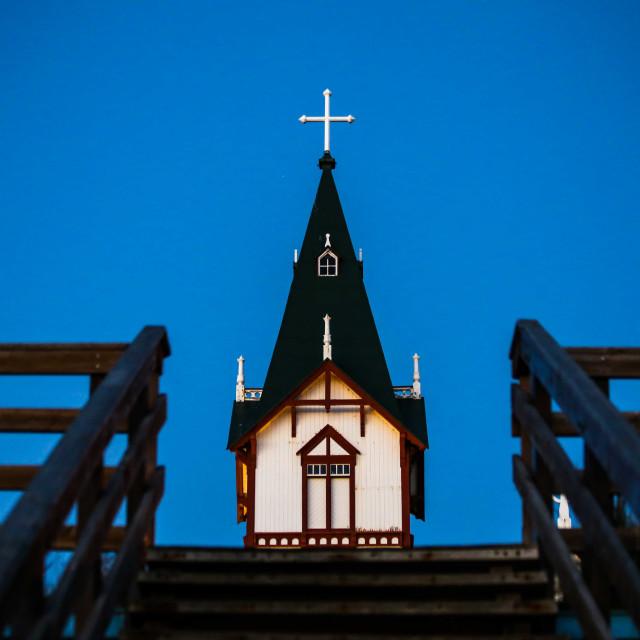 """Looking up from Husavik Harbor to Husavik Church, Iceland"" stock image"