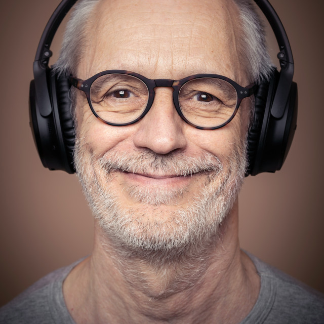 """""""Portrait of adult man with beard wearing stereo headset and glas"""" stock image"""