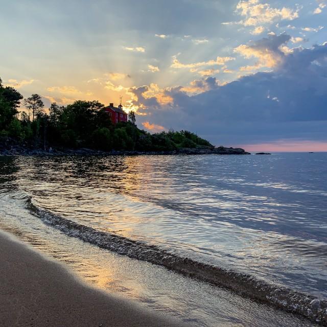 """Lighthouse sunrise, Marquette"" stock image"