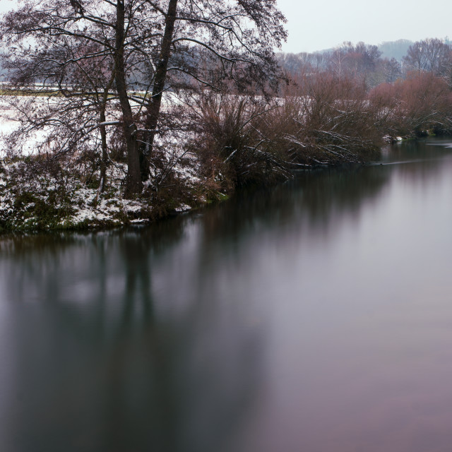 """""""Snow on the riverbank"""" stock image"""