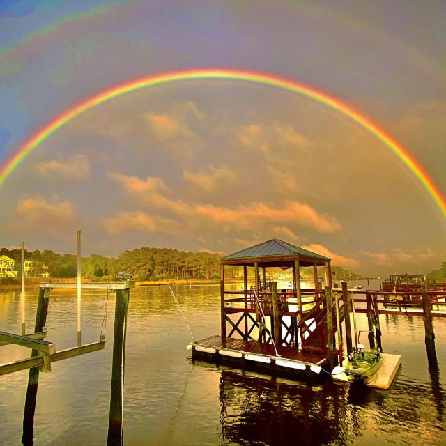 """Rainbow over intercoastal waterway"" stock image"