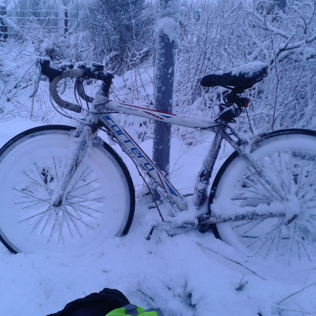 """""""Cycling in snow in The Highlands of Scotland"""" stock image"""