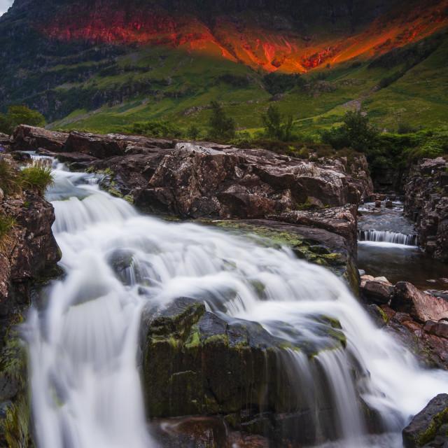 """Waterfall at sunset"" stock image"