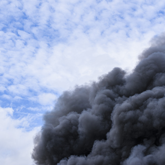 """""""Toxic smoke from industry on fire"""" stock image"""