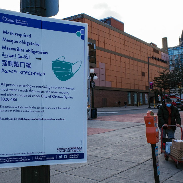 """Multilingual 'mask required' sign in ByWard Market"" stock image"