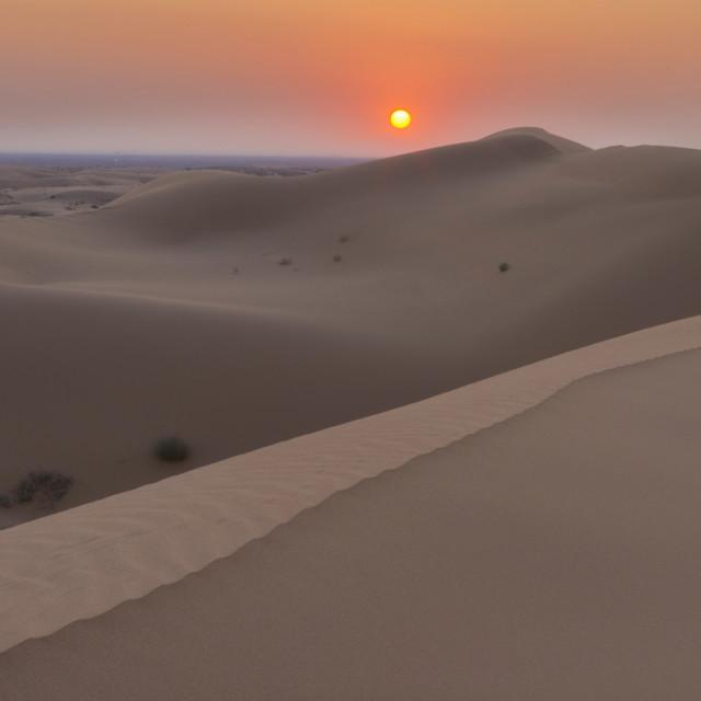 """""""Sunrise over the desert."""" stock image"""