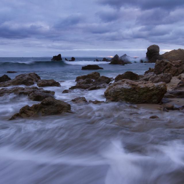 """Dusk along the coast under threatening clouds"" stock image"