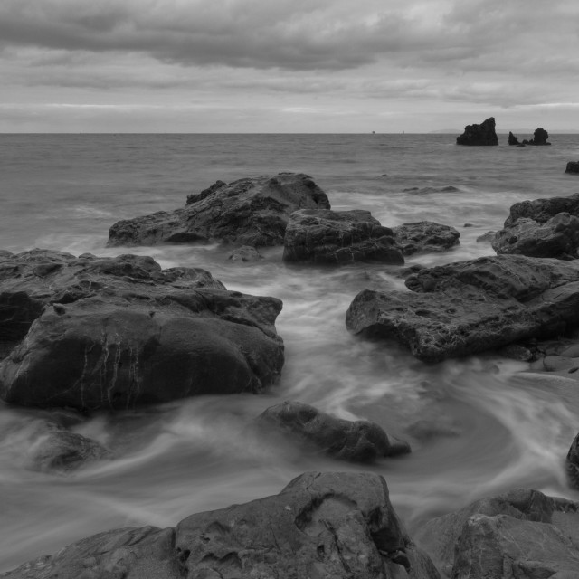 """Water moving through the coastal rocks"" stock image"