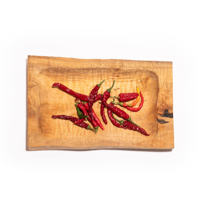 """""""Chilli peppers on a rough wooden tray"""" stock image"""