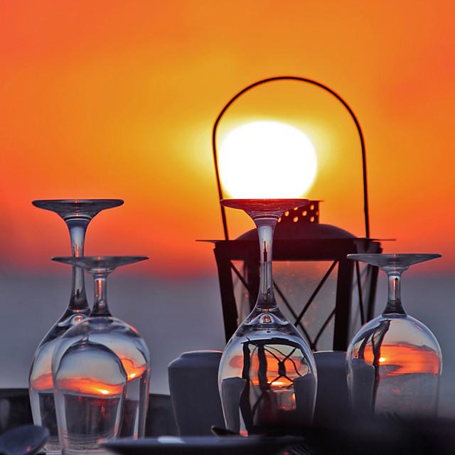 """Wine glasses at sunset"" stock image"