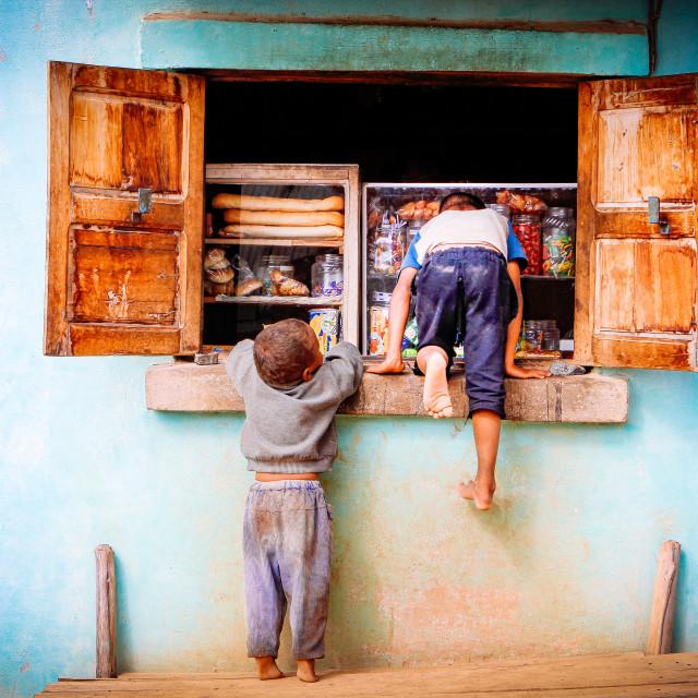 """Snapshot curious boys entering a shop window"" stock image"