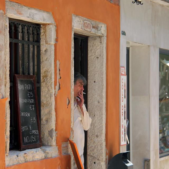 """""""Man smoking, Venice, Italy"""" stock image"""