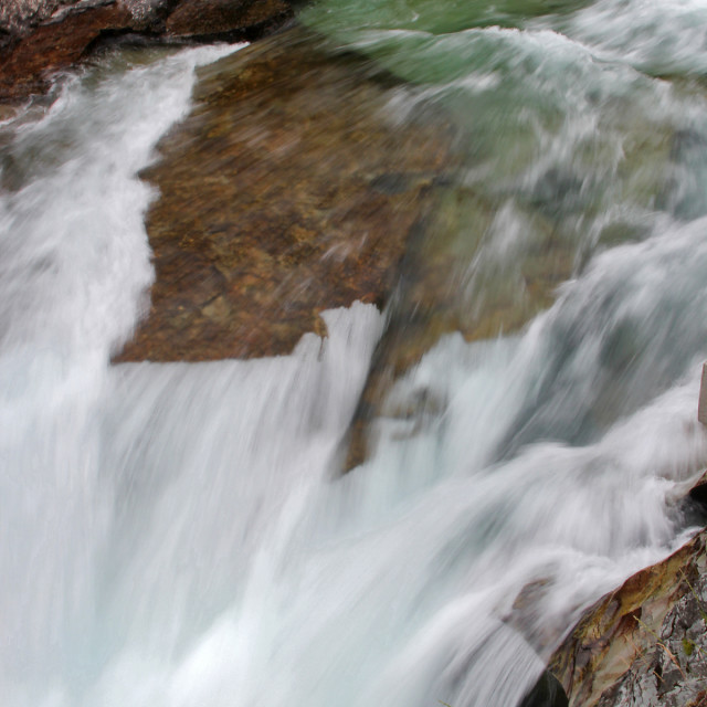 """Waterfall, glacier national Park"" stock image"