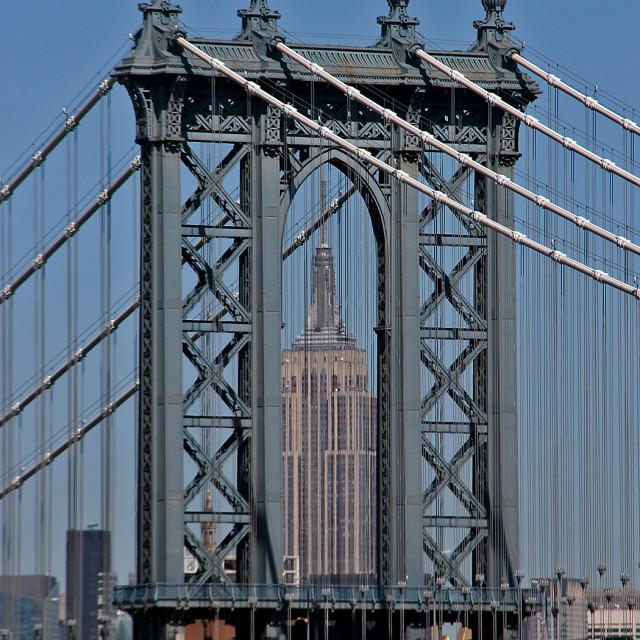 """Empire State building through Brooklyn Bridge"" stock image"