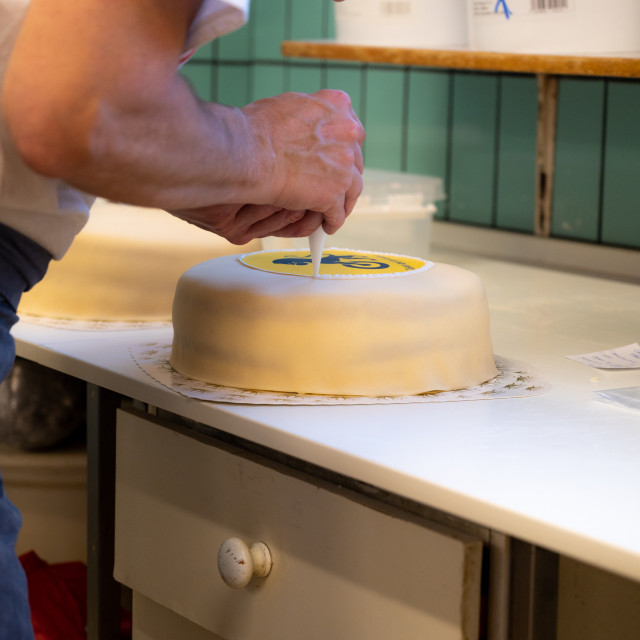"""Cake being decorated"" stock image"