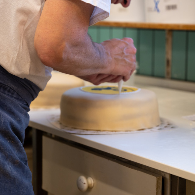 """""""Cake being decorated"""" stock image"""
