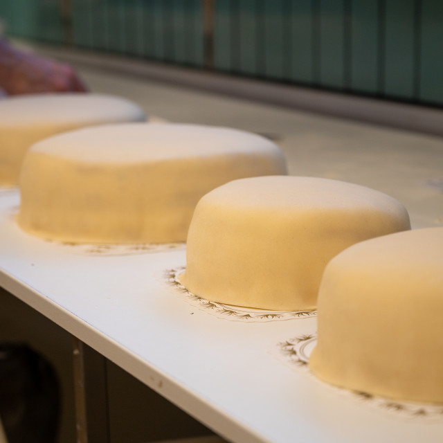 """Row of cakes"" stock image"