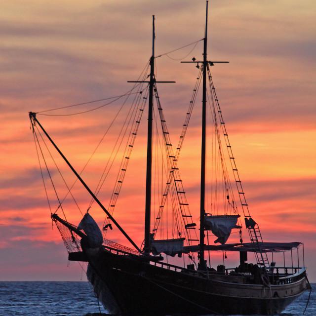 """Sailboat and sunset, Aruba"" stock image"