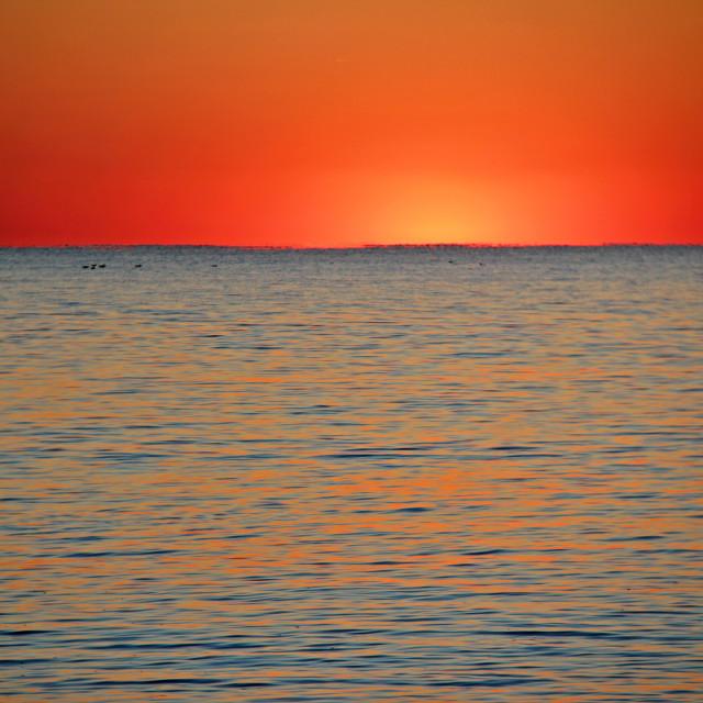 """Sunset, Oak Island, North Carolina"" stock image"