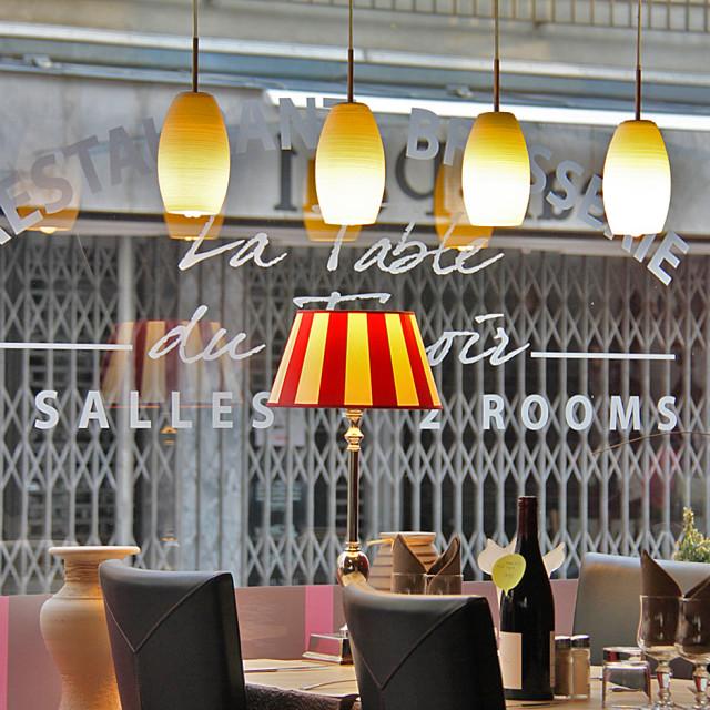 """Restaurant table, Bayeux, France"" stock image"