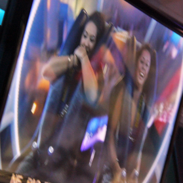 """Rachel and Caroline, carnival ride, Paris"" stock image"