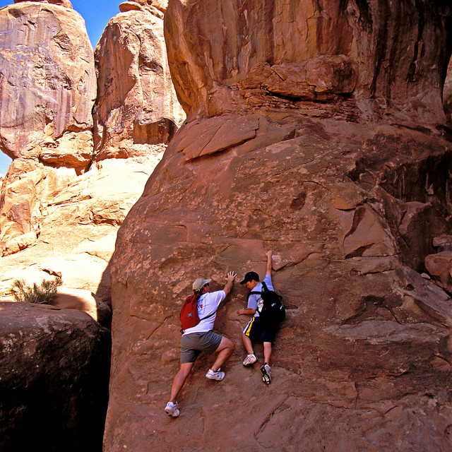 """""""Mac and Kevin free scaling, Arches national Park"""" stock image"""