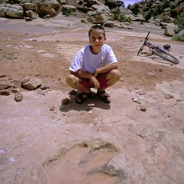 """Michael and allosaurus footprint"" stock image"
