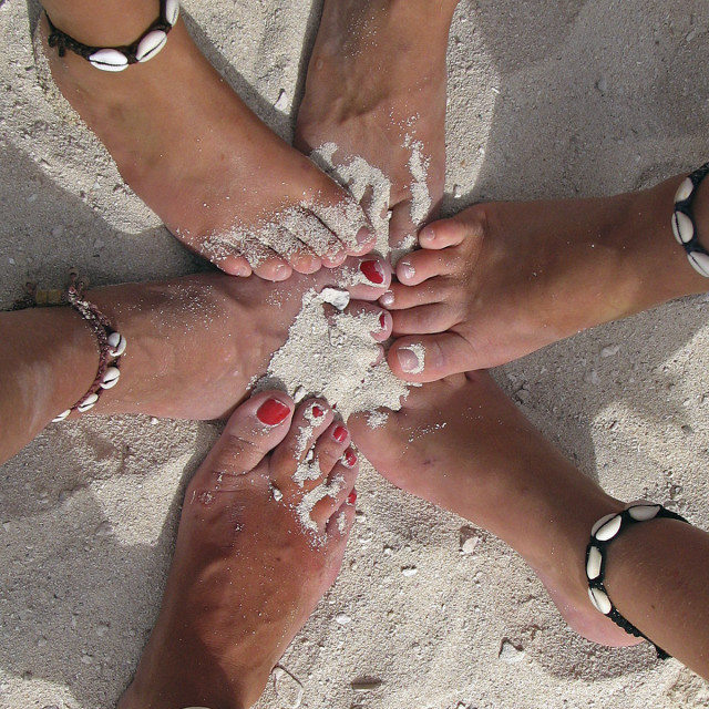 """""""Ankle bracelets in the sand"""" stock image"""