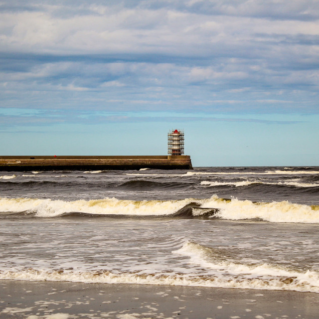 """""""Lighthouse beyond the waves."""" stock image"""