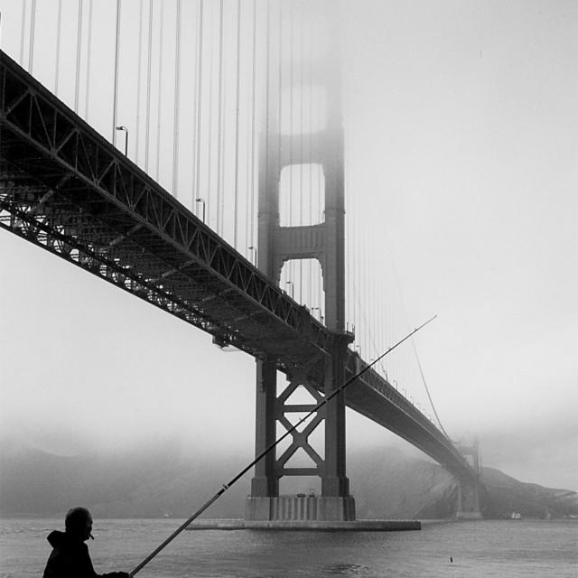 """""""Fisherman at Golden gate Bridge"""" stock image"""