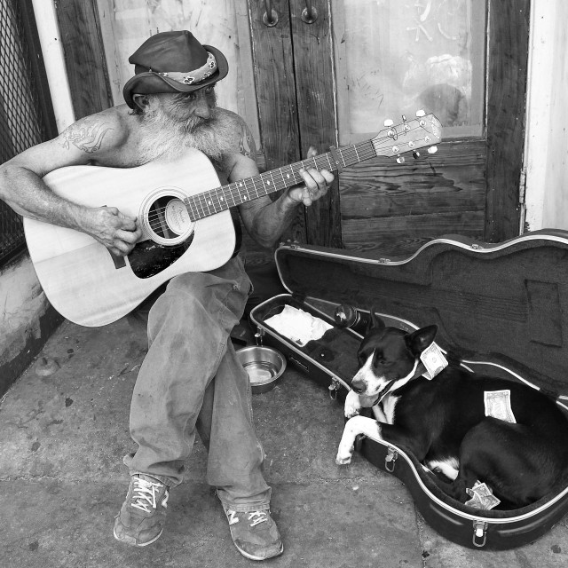 """""""Guitar player with dog, New Orleans"""" stock image"""