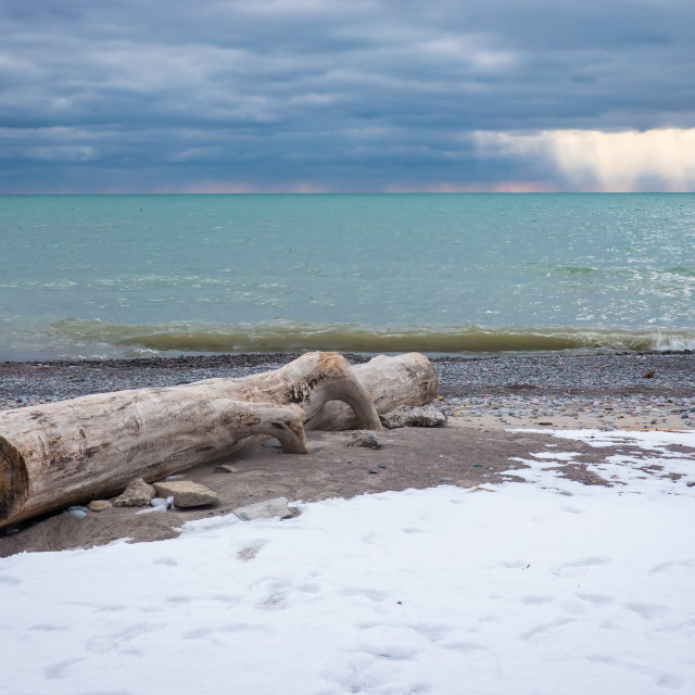 """Old Log And Dramatic Skies in Pickering, Ontario"" stock image"