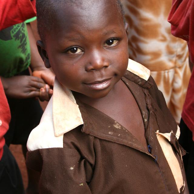 """Smiling school boy Uganda, Africa"" stock image"