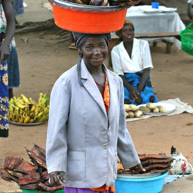 """""""Woman balancing fish"""" stock image"""