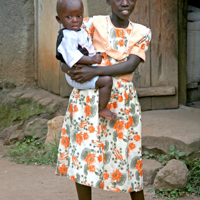 """Girl and brother, Uganda, Africa"" stock image"