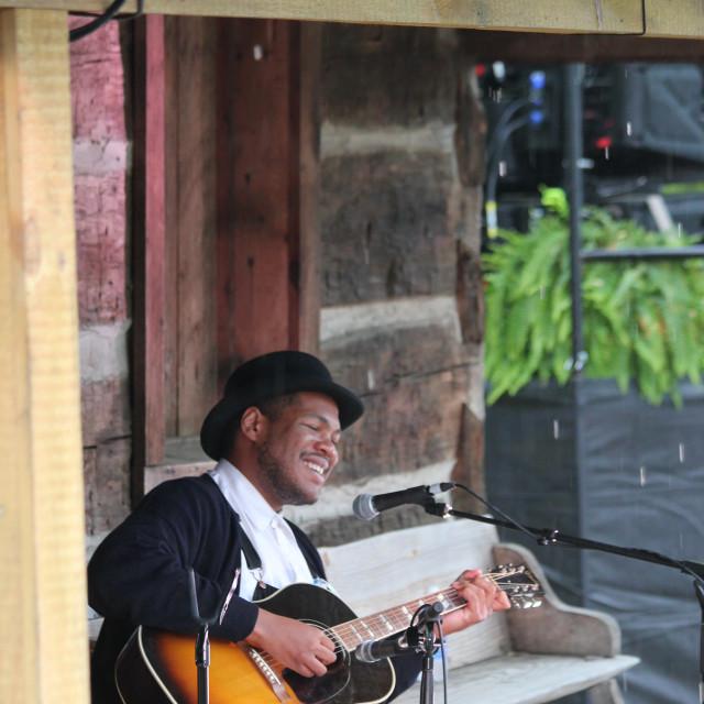 """Singing in the rain, Merlefest"" stock image"