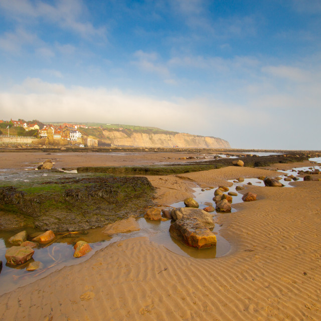 """Rockpools and Beach at Robin Hoods Bay, Yorkshire East Coast, England. A Panoramic View from the Beach"" stock image"