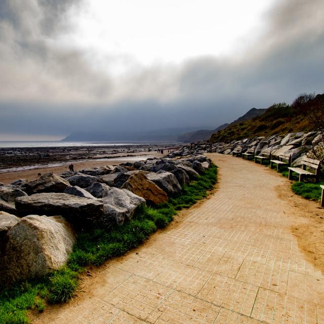 """Promenade, Walk next to Rock Sea Defences at Robin Hoods Bay, Yorkshire East Coast, England."" stock image"