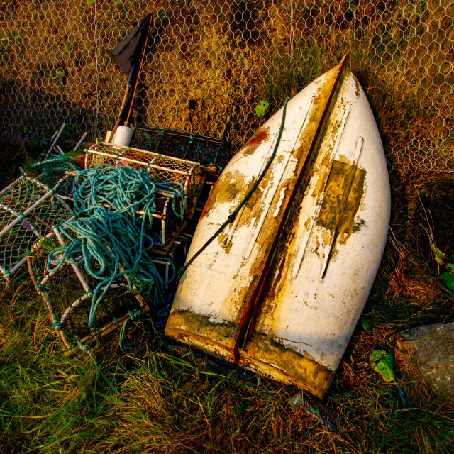 """""""Overturned dinghy, Rope coil and Lobster pot at Robin Hoods Bay, Yorkshire East Coast, England."""" stock image"""