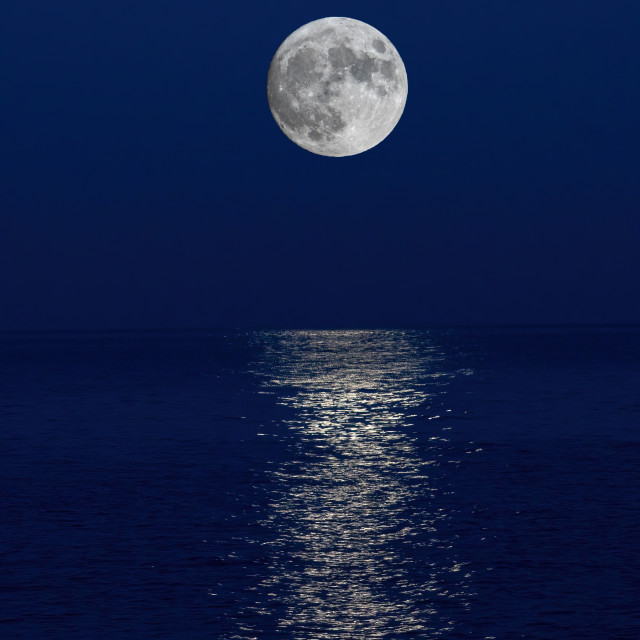 """Full moon reflection over the evening sea in Spanish Costa Brava"" stock image"