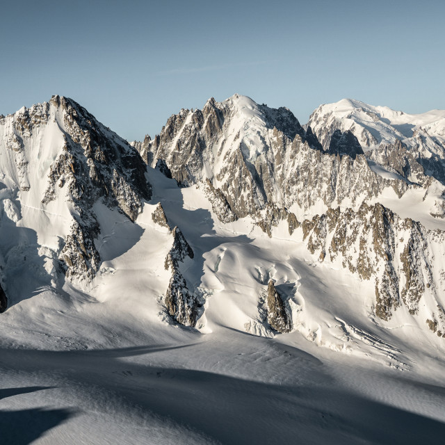 """Sunrise over Giants. Aiguille du Chardonnet (3824), Aiguille Verte (4122) and Mont Blanc (4810)."" stock image"