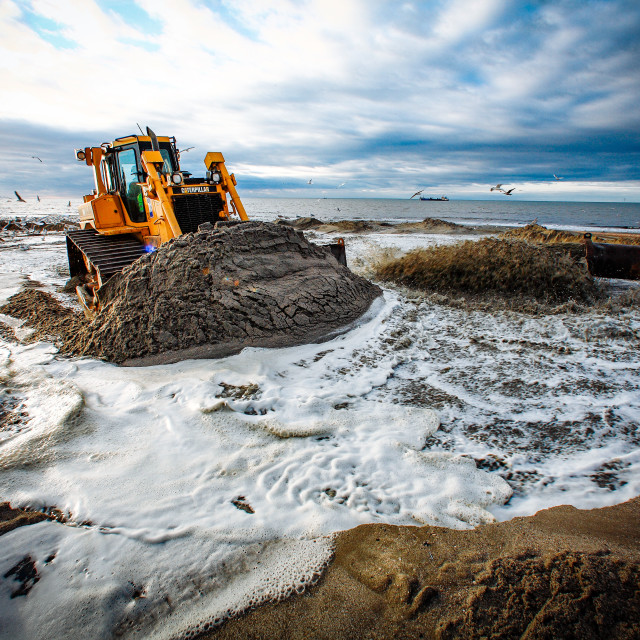 """Sand flushing with heavy equipment to secure the coast and the s"" stock image"