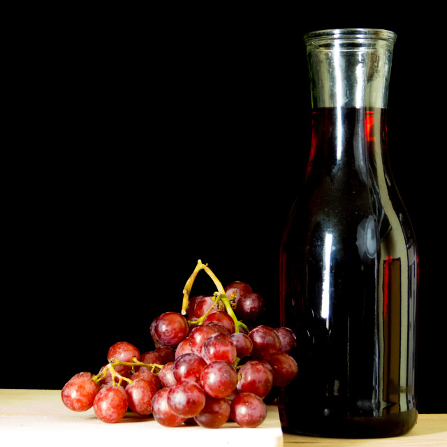 """Grapes and wine decanter"" stock image"